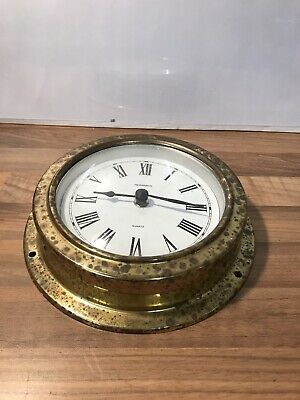 Quartz bulkhead ships clock style in a brass case Used But Fully Working .