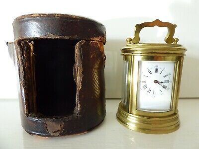 Miniature oval French carriage clock with original box and key. For repair.