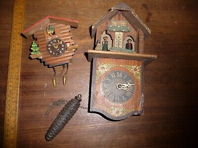 Pair of Vintage Cuckoo Clocks.Miniature key wind + weighted Weather house clock