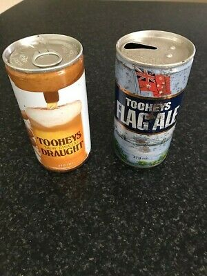 old Steel beer cans. 1 Tooheys New Draught un opened can. 1 Flag Ale can Empty.