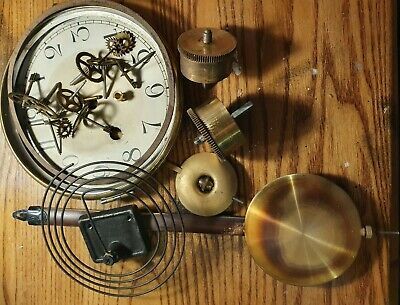 Assorted clock  parts including face and pendulums for spares or repair