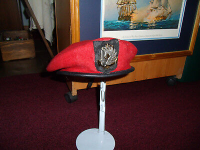 French Colonial Paratrooper red beret and insignia.Great looking item