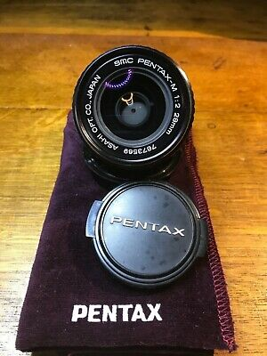 SMC Pentax M 28mm f2 excellent. Adapt to DSLR or mirrorless