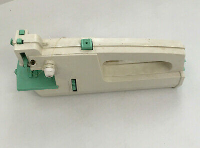 vintage 1973  plastic portable hand held sewing machine sold as is for parts
