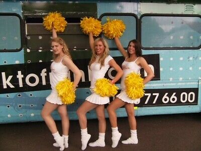 Pair of Professional yellow cheerleading pompoms used by cheerleaders at events