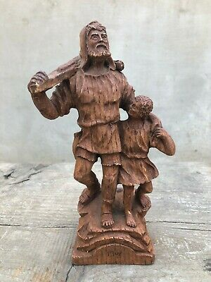 Vintage   wooden statue of an old man and a boy. Handmade. Kind of wood carving