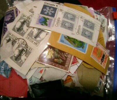 200g Of Worldwide Stamps On Off Paper unsorted