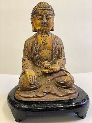 Antique Asian Guilted Bronze Seated Buddha on Painted Wood Base Featuring Manji