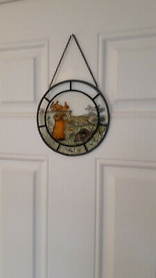Novelty glass circular hanging picture of rabbits, with black rim & chain. Used