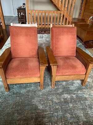 A pair of Stickley Mission Oak Spindle Morris Chairs