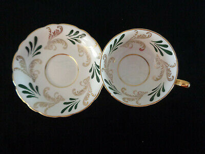 Paragon White With A Black And Gold Design Tea Cup And Saucer