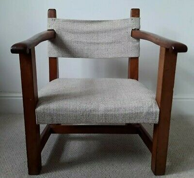An Early 20th Century Arts And Crafts Low Fireside Armchair Solid Mahogany Frame
