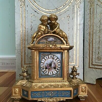 Antique French gilt bronze and porcelain clock with cherubs, circa 19 century