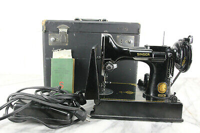 Model 221 Featherweight Sewing Machine by The Singer Manufacturing Co., 1953