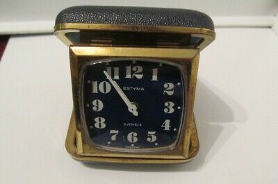 Vintage Estyma 2 jewel folding travel alarm clock. Good working order.