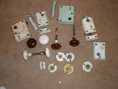 Sets of white and brown marbled porcelain door knobs and hardware.