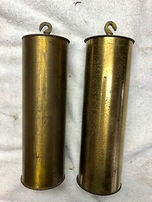 ANTIQUE BRASS WEIGHTS FOR TWO TRAIN CLOCKS. Knurled caps