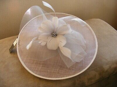 M&Co silver fascinator with flower and feathers, satin headband Brand new