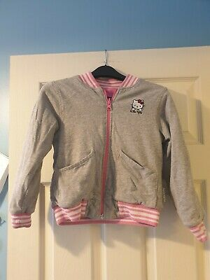 Girl's H&M reversible Hello Kitty jersey bomber jacket. Age 5-6 years. Pink/grey