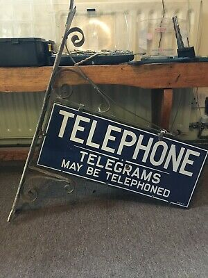 Vintage enamel telephone and telegram sign with wall bracket