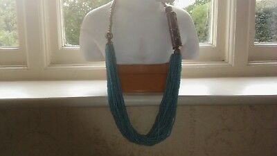 Fine turquoise bead with white metal hook and eye necklace