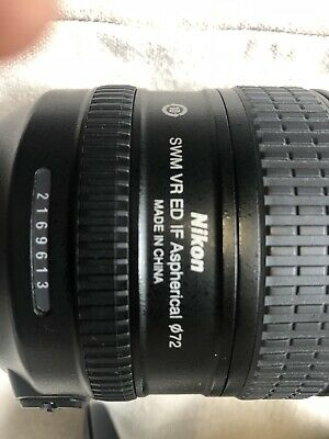 AF-S Nikkor 24-85mm f/3.5-4.5 lens with lens cap and cover (Nikon)