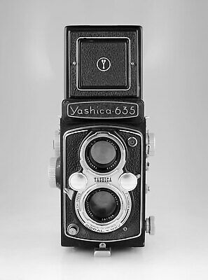 Yashica 635 with with 35mm film adaptor kit in leather case & Sunpak flash