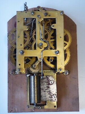 Antique musical clock movement for spares or repair.