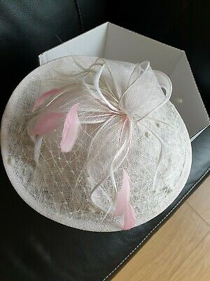 Custom made Ivory Facinator Wedding hat with soft pink feather flashings