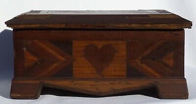 An old intricately decorated with matchsticks and inlay hearts and geometrics.