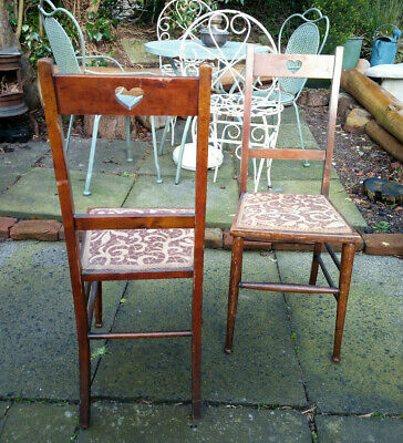 Matching Pair of Arts and Crafts Chairs with Pierced Heart Carving