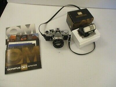 Olympus OM1 35mm  SLR complete with Manuals and Olympus Flash unit in box