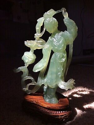 Chinese hand carved Jade Noble Lady figurine on wooded stand.