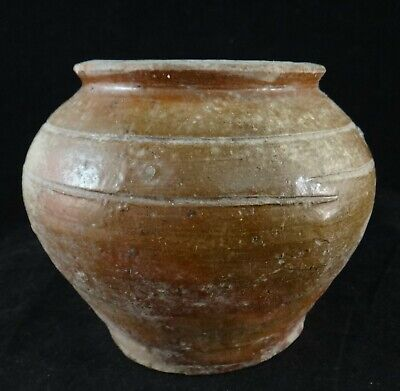 """Han Dynasty Chinese Pottery Brown Glazed Jar (206BC-220AD). 5"""" dia, 4 ¼"""" tall."""