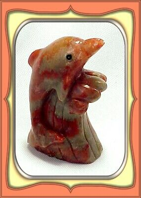**249.0ct Fossilized Utah Red Horn Coral Dolphin Carving**