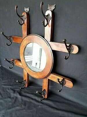 Early 20th century oak wall mounted coat and hat rack with mirror