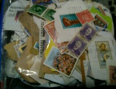 200g Of Worldwide Stamps On Off Paper unchecked