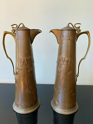 Fabulous pair of tall Art Nouveau Copper Claret Jugs by Carl Deffner.