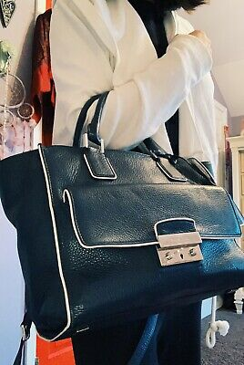 Michael kors navy blue leather handbags with white outlining