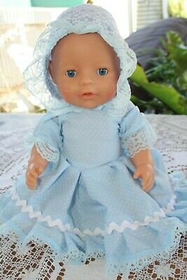 ZAPF CREATION DRESSED DOLLWITH BLUE EYES. 42 cms in LENGTH. 2013  FREE POSTAGE