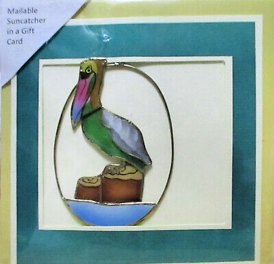 Mailable suncatcher in a gift card features Pelican.  Goes regular mail 1 stamp