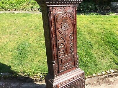 Victorian   brass faced 8 day grandfather clock with  carved oak case