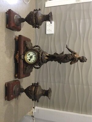 Antique 1800's spelter clock and garnitures set