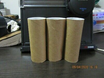used brown rolled cardboard from toilet rolls
