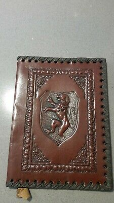 Two vintage embossed leather book covers made in Italy