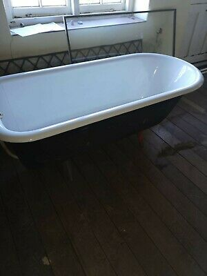 Lovely Victorian style cast iron roll top bath with feet.