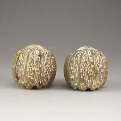 A Pair of Chinese Ox Horn Walnut Gymnastic Balls
