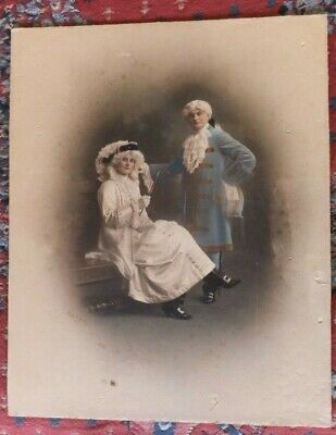 hand colored  daguerreotype photograph of a Lady and Gentlemen by Mason