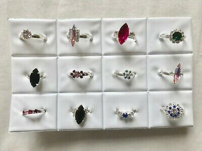 JOBLOT- 12 kids/woman rings of 12 styles crystal/colour diamante. Silver plated.