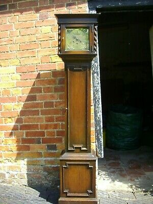 Sweet little westminster chime 8 day grandmother clock.Brass dial oak case NO Re